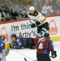 0683 Colorado Avalanche #22 Scott Hannan gets slamed into the wall giving  Boston Bruins #12 Chuck...