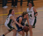 (Denver, Co.-Jan. 13, 2005)  Denver Christian's Kiley Gill, middle, is fouled by Machebeuf's Erin...