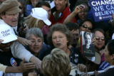 Supporters strain to shake hands with Sen. Hillary Clintons as she presses the flesh after...
