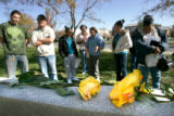 BG0158 Yellow roses are laid on a memorial as students cope with the loss of fellow George...