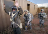 Members of  Gator company of the 2nd Battalion 12th Infantry Regiment, came into a mock...