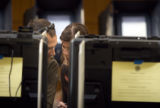 (242) Jamison Ziesch, 33, left, consults with Michelle Sedillo, 42, both of Denver, as they  of...