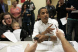 Barack Obama makes voter contact phone calls from the Obama for President office in Brighton,...