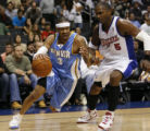 LAS103 - Denver Nuggets guard Allen Iverson (3) drives on Los Angeles Clippers guard Cuttino...