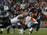 JPM187 Denver Broncos Jay Cutler scrambles as Jacksonville Jaguars Reggie Hayward (97) strips the...