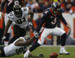 JPM189 Denver Broncos Jay Cutler scrambles as Jacksonville Jaguars Reggie Hayward (97) strips the...