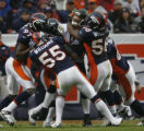 JPM535Denver Broncos Boss Bailey, D.J. Williams, Nate Webster gang tackle Jacksonville Jaguars...