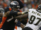 JPM846 Denver Broncos offensive tackle Ryan Harris (74) blocks  Jacksonville Jaguars defensive end...
