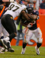 DM0309  NFL_BRONCOS_JAGUARS+55105  Denver Broncos running back Michael Pittman #28 tries to fight...
