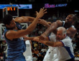 (DENVER, CO., JANUARY 14, 2005) Denver Nuggets' #31, Nene, right, and Minnesota Timberwolves' #34,...