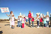 Kindergarteners in an after school program at Sunrise Elementary School in Aurora, Colo., give...