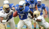 Air Force quarterback Tim Jefferson (7) runs against Navy in the fourth quarter at Falcon Stadium...