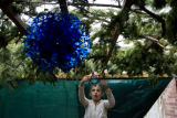 Arielle Williamson, 8, (cq) hangs the Star of David on her families sukkah. The holiday Sukkot...