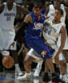(Denver, CO  on 12/31/2004 ) -Philadelphia 76ers guard Allen Iverson, right, loses the ball...