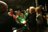 Marilyn Musgrave shakes hands with a supporter after debating Betsy Markey for in the 4th...