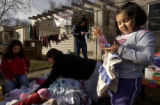 (DENVER, Colo., December 31, 2004) Yamilet (cq Yamilet Hernandez, 4, looks at her new doll she got...