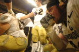 (DENVER, CO., DECEMBER 29, 2004)  University of Colorado team captain #60, Matt McChesney, right,...