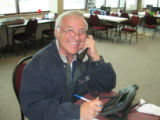 Bob Martinez, former chairman of the Colorado Republican Party, helps call voters at the...