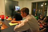 Kaleb Brooks (cq), center, takes notes during the Presidential debate, Wednesday evening, October...