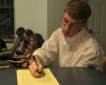 Kaleb Brooks (cq), right, takes notes during the Presidential debate, Wednesday evening, October...