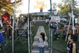 (from left) 4 year-old Jaritzia Nevarez (cq) and 6 year-old Oscar Morova peek through the gates of...