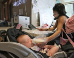 Ann Macaulay (cq), feeds her baby, Ann Marie Macaulay, while working the phone bank for McCain for...