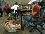 Becky Swan (cq), works the phone bank for McCain for President, while her baby, Kaycee Swan, 3...