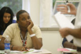 Manual High School sophomore, Jamayah Brown (cq) listens to her geography teacher, Mr. Charlie...