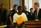 Suspect Willie Clark is advised of the charges against him for the killing of Darrent Williams in...