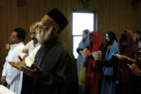 (DENVER Colo., January 2, 2005)   Father George Parathuvayalil (cq) (beard - black hat) leads his...