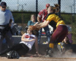 Windsor Wizards' Kelsey Tillery catcher tags out Castle View's Harmony Englert in the 4A semi...
