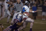 Cherry Creek's Bryan Price (27) tackles Grandview running back Zach Horan during the first half on...