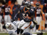 (DENVER, Co., SHOT 1/2/2005) The Denver Broncos' Kelly Herndon (#31, CB) escapes the grasp of the...