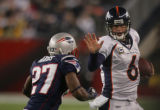 (CS179) Jay Cutler is pursued by Ellis Hobbs III in the first quarter of the Denver Broncos...