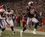 JPM502 Denver Broncos  Jack Williams and Kenny Peterson chase New England Patriots Randy Moss into...