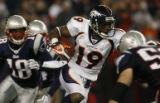 JPM572 Denver Broncos Eddie Royal returns a punt against the New England Patriots in the third...
