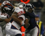 JPM613 Denver Broncos running back Michael Pittman is stopped by  New England Patriots linebacker...