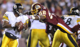 FDX208 - Washington Redskins linebacker Rocky McIntosh (52) leaps for Pittsburgh Steelers...