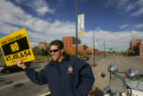 (CS0076) Denver Fire Department Captain Greg Pixley holds up sign against prop. 47, 49 and 54 at...