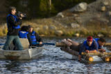 (900) Marcus Leibrecht, 44, right, looks toward the shore as he hand-paddles cold water off of a...