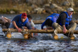 (902)  Marcus Leibrecht, 44, left and Dell Weingarten, 54, right hand-paddle cold water on a...