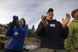 (964) Dell Weingarten, 54, right, and Rosanna Garcia, left, clap their hands welcoming back their...