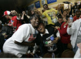 People attending the Obama victory party at Brother Jeff's Cultural Center in Denver, November 4,...