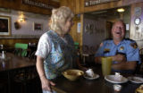 (HUGO, Colo, October 18, 2004) Leroy Yowell jokes with Jean Scott, owner of a local diner in Hugo,...
