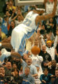[(Denver, CO, Shot on: 11/4/04)] Fans chear on Denver Nuggets Marcus Camby as he slams the ball...