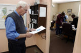 (Paonia, Colo, October 20, 2004) Mayor Robert Johnson,checks his mail at the Paonia town hall. He...