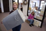 (HOTCHKISS, Colo, October 20, 2004) Hotchkiss City Clerk Marlene Searle holds up the towns...