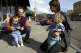 (Paonia, Colo, October 20, 2004) Neal Schwieterman,(left) a stay at home dad holds his daughter...