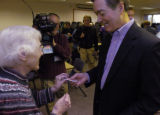 "(Littleton., on Sun. Oct. 21, 2004) Colorado Gov. Bill Owens receives a ""I Voted""..."
