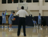 (Denver, CO  on 12/29/2004 ) - New Denver Nuggets coach Michael Cooper watches players shooting...